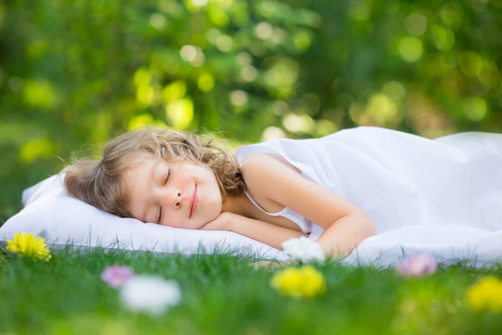 Mattress on Grass with Sleeping Girl